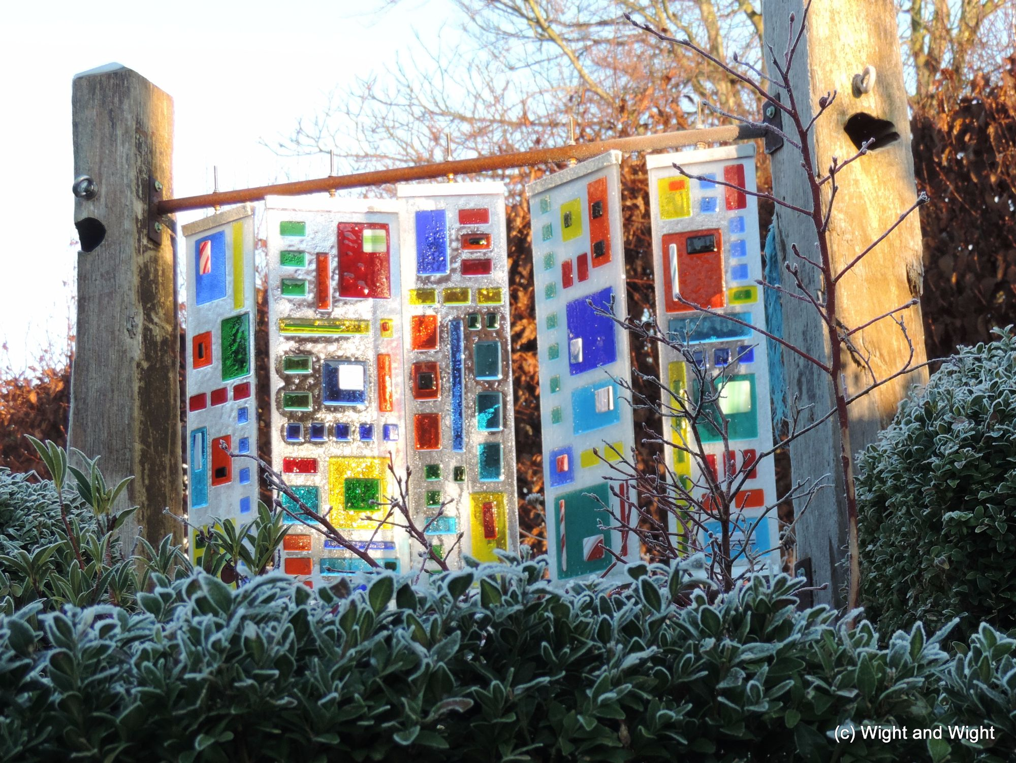 fused glass and reclaimed wood garden art
