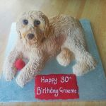 Dog sculpted birthday cake