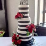 Black & White theme wedding cake with topper