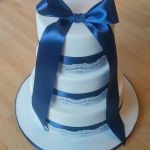 navy wedding cake with lace overlay