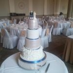 White Ruffles with blue ribbon wedding cake