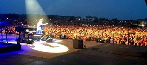 Elton John Performing to a crowd Lincoln Showground