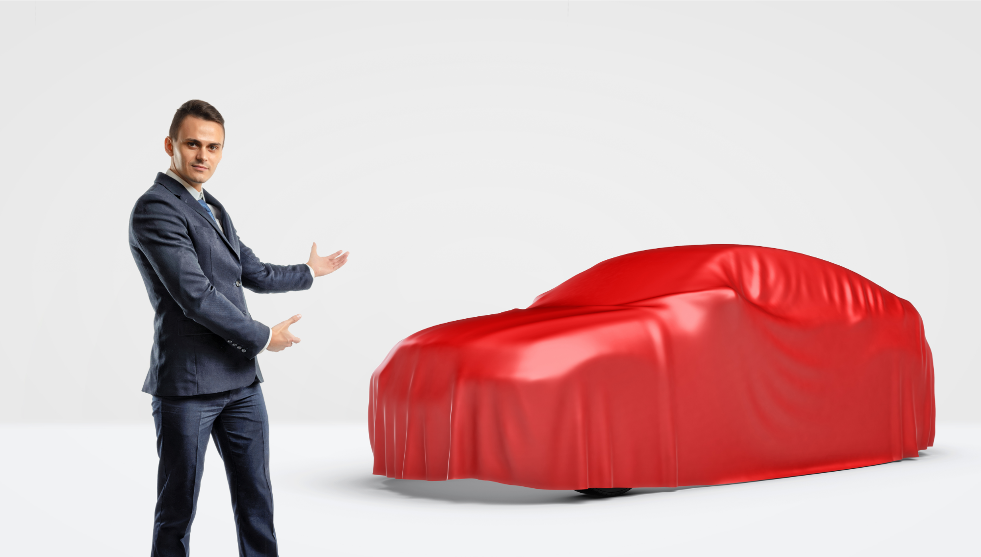 Car Salesman unveiling a car