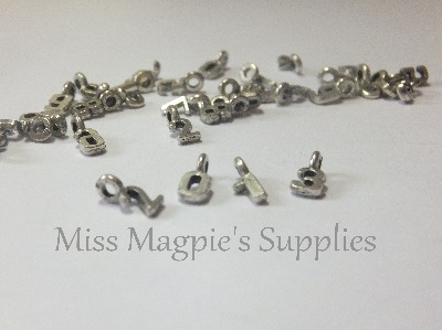 SILVER TONE - MIX OF TINY NUMBERS - PACK OF 50