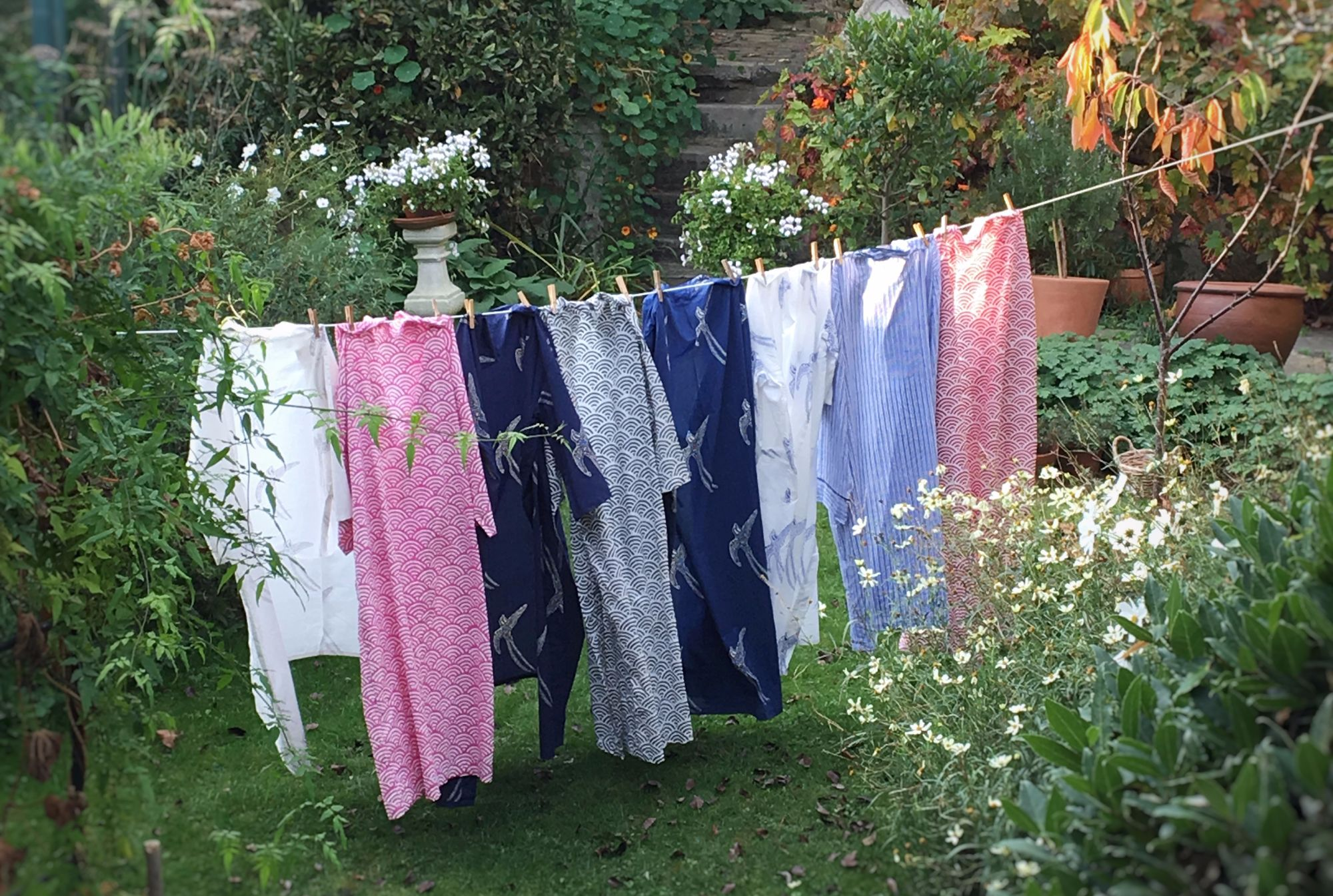 kimonos hung up on a washing line in the gardne