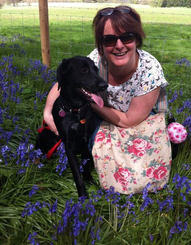 Poppy finding the bluebells!