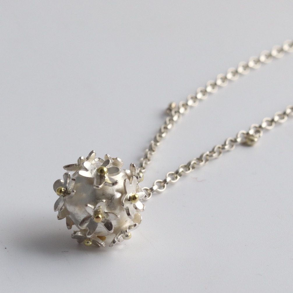 Silver flower bomb necklace with gold detail