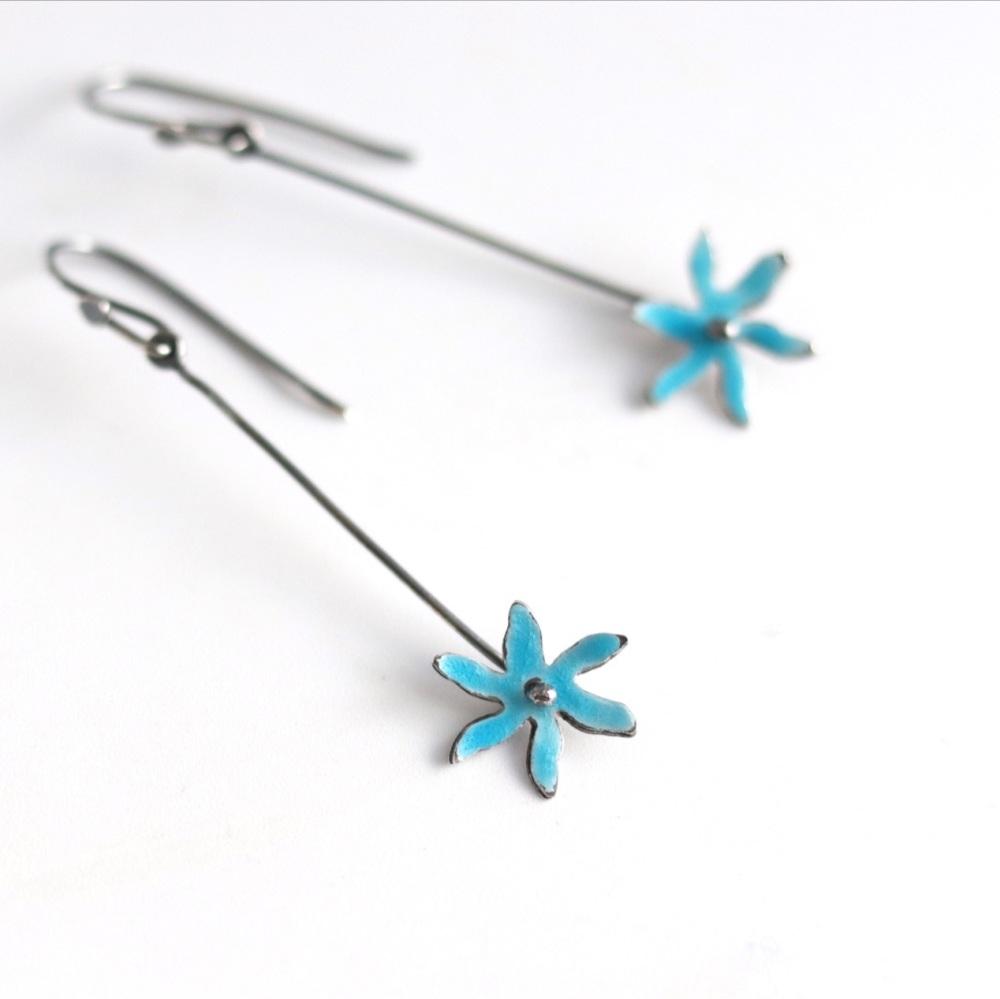 Long star flower enamel earrings