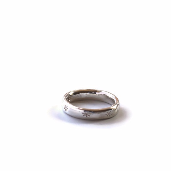 Silver band ring with star stampings