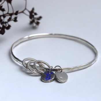 Silver Bangle with Beaten Finish and Flower Stampings with Two Nugget Charms and Three Silver Loops