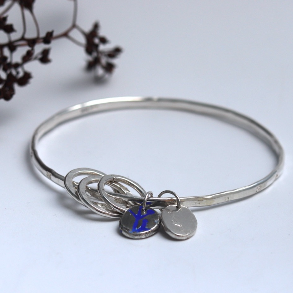 Silver Bangle with Beaten Finish and Flower Stampings with Two Nugget Charm