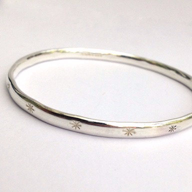 Silver Bangle with Star Stampings.