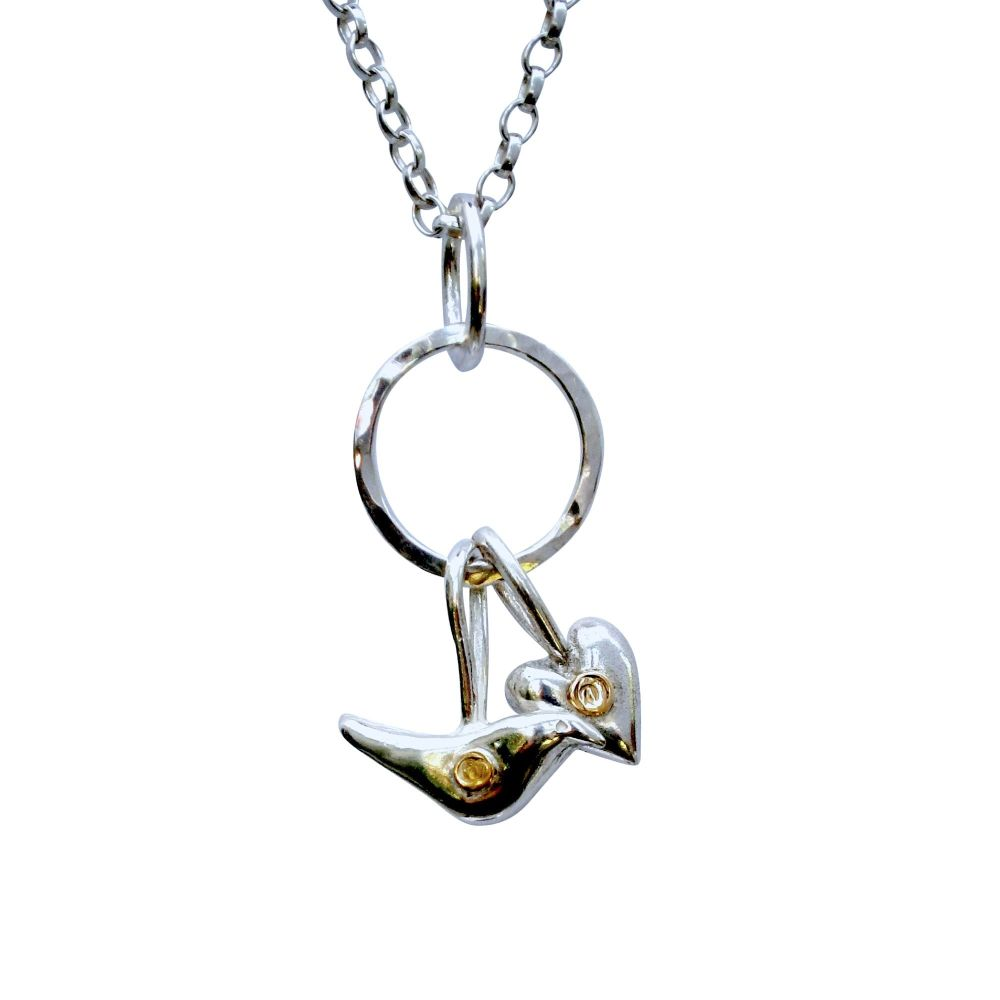 Bird and Heart with gold necklace