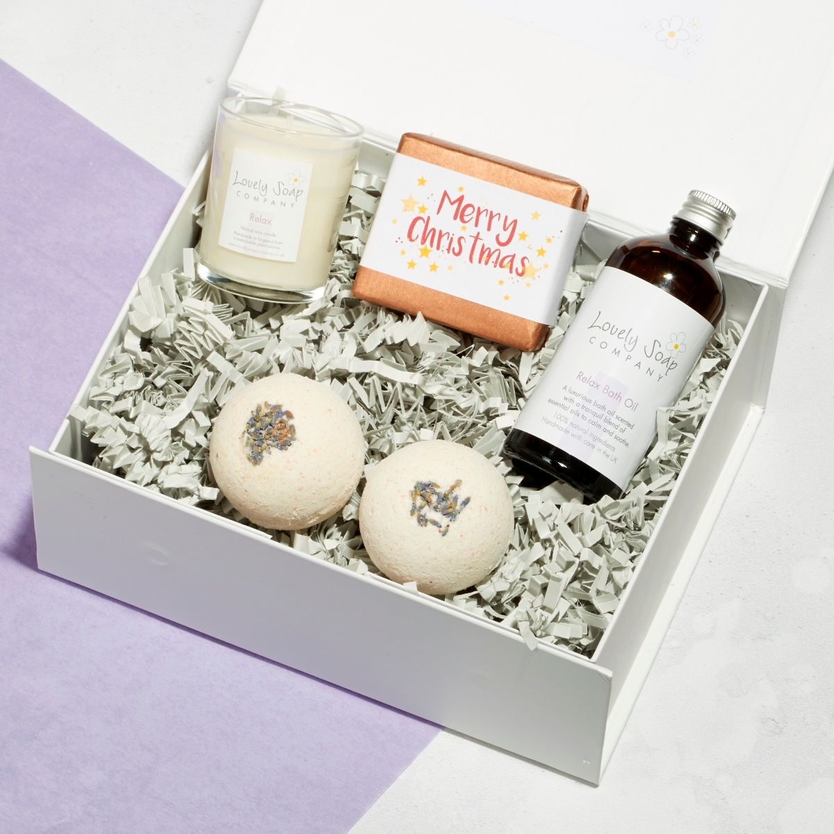 relaxing xmas pamper hamper with lavender bath bombs, relaxing bath oil, lavender candle, lavender soap
