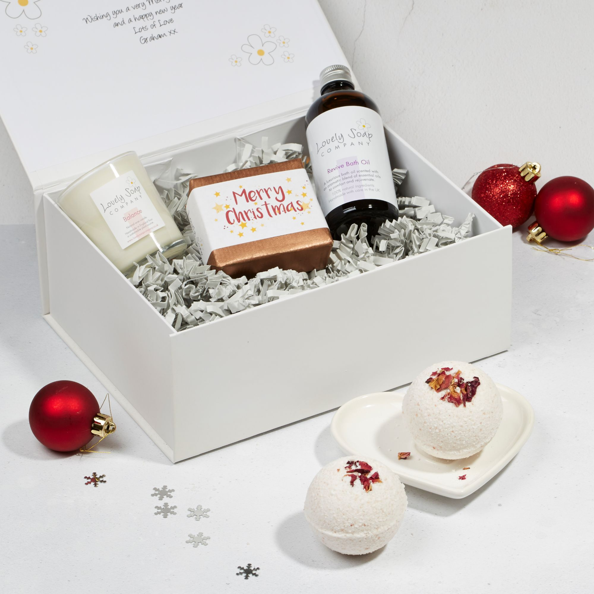 Revive xmas pamper hamper with rose geranium bath bombs, balance candle, revive bath oil and lavender soap