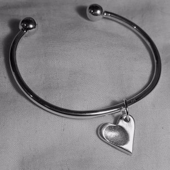 Torque bangle with fingerprint charm