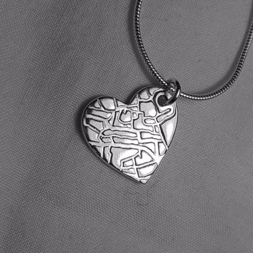 Maps in silver necklace