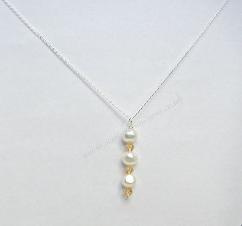 White Freshwater Pearls & Gold Bicone Pendant Necklace