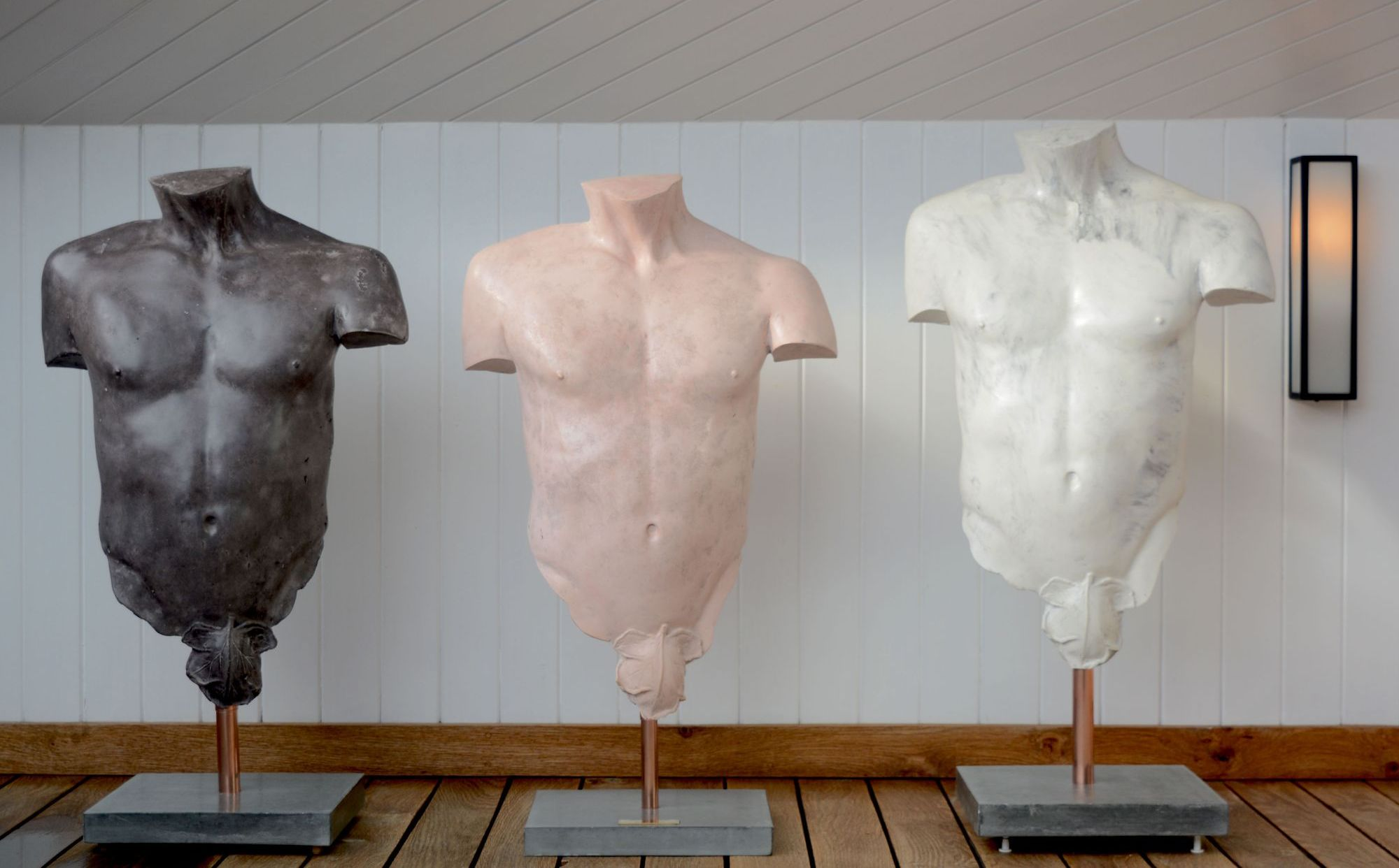 3 polished concrete male torso sculptures