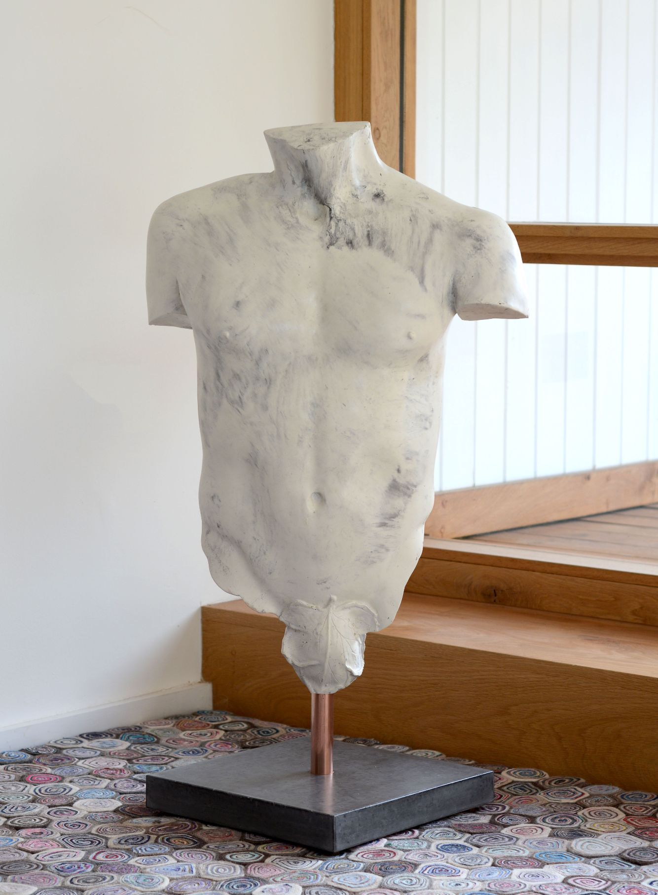 White marble effect polished concrete torso sculpture