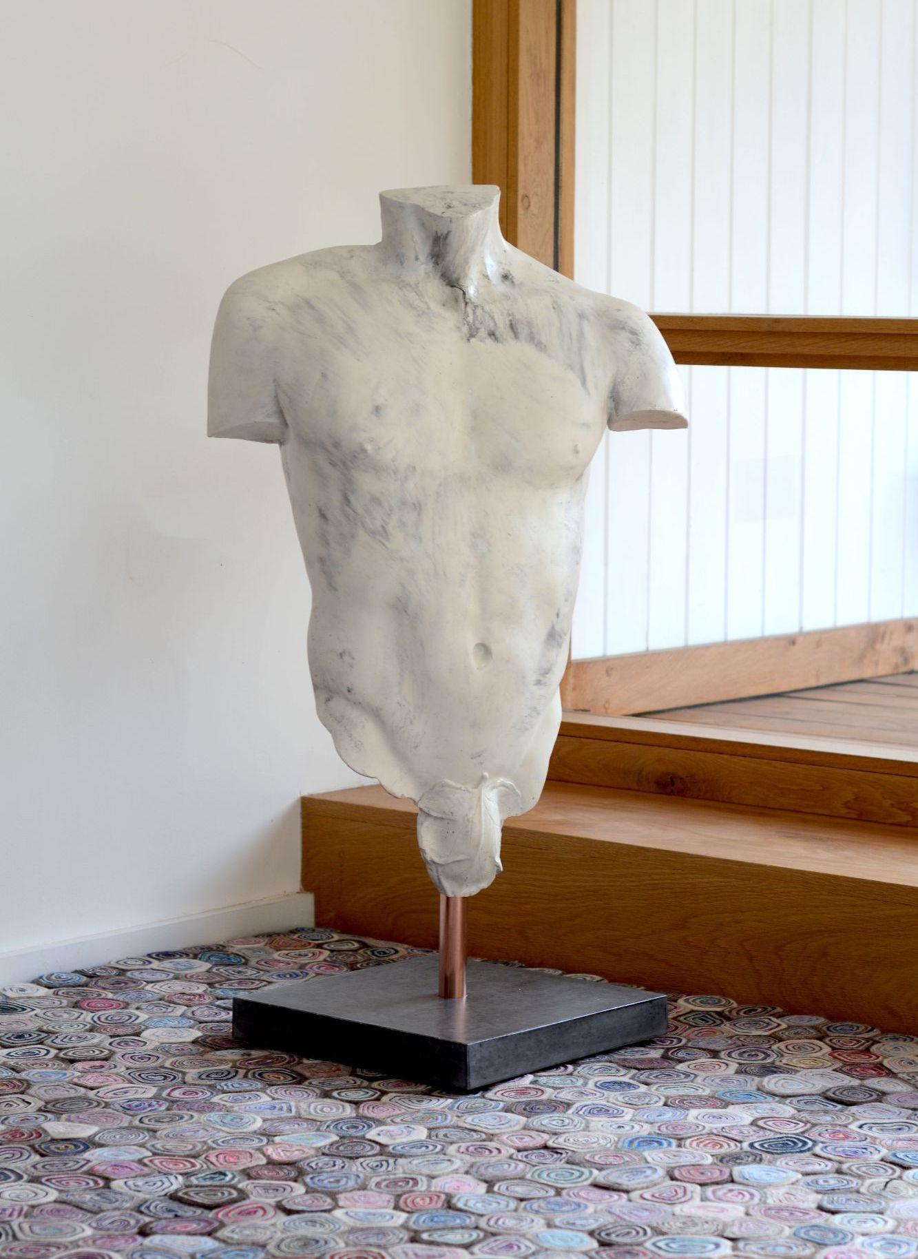 Polished white marble effect concrete male torso