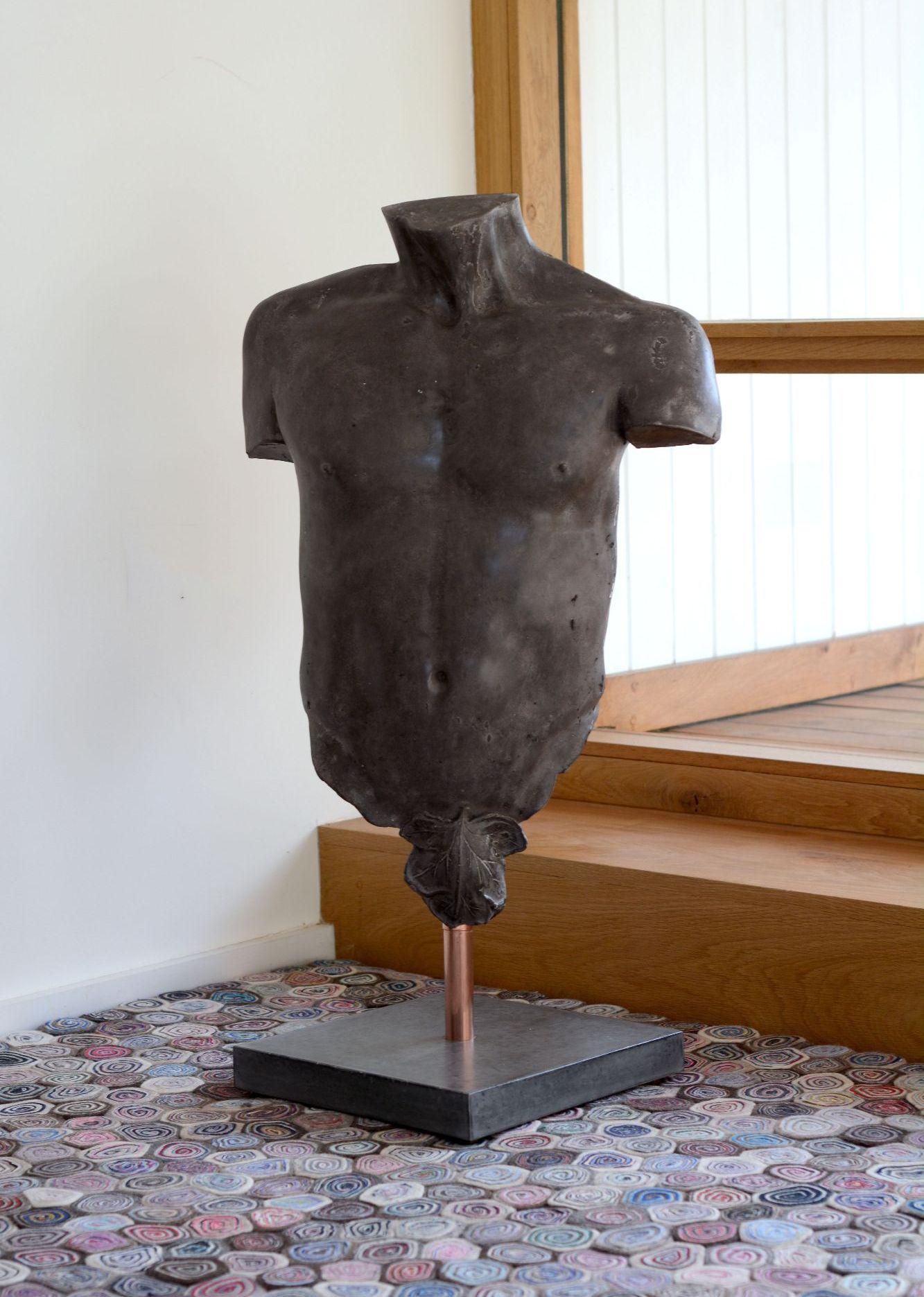 Polished black concrete male torso
