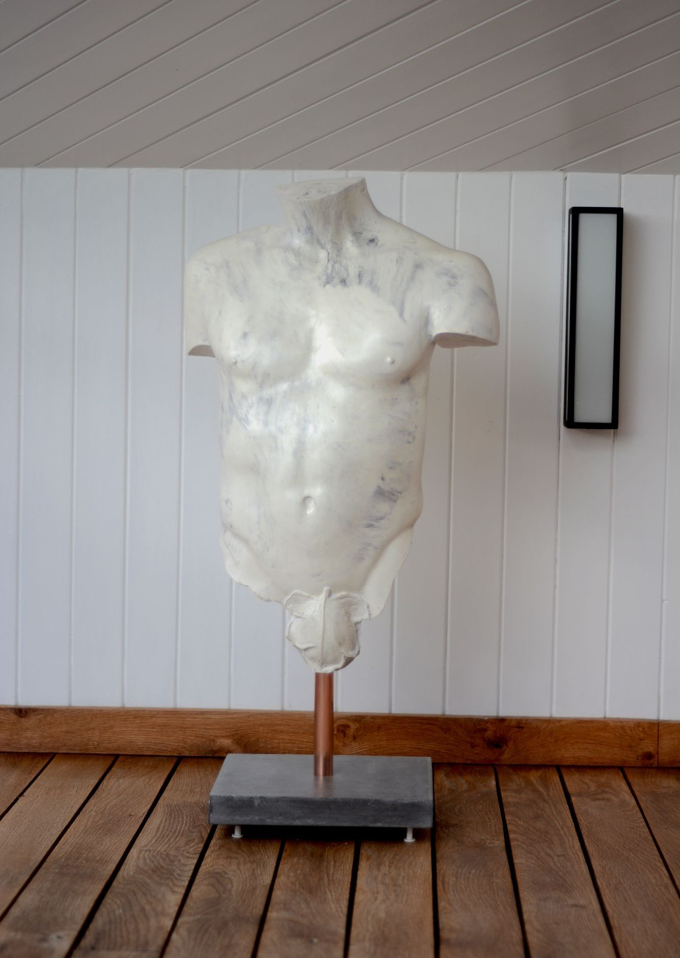 White marble effect polished concrete male torso sculpture