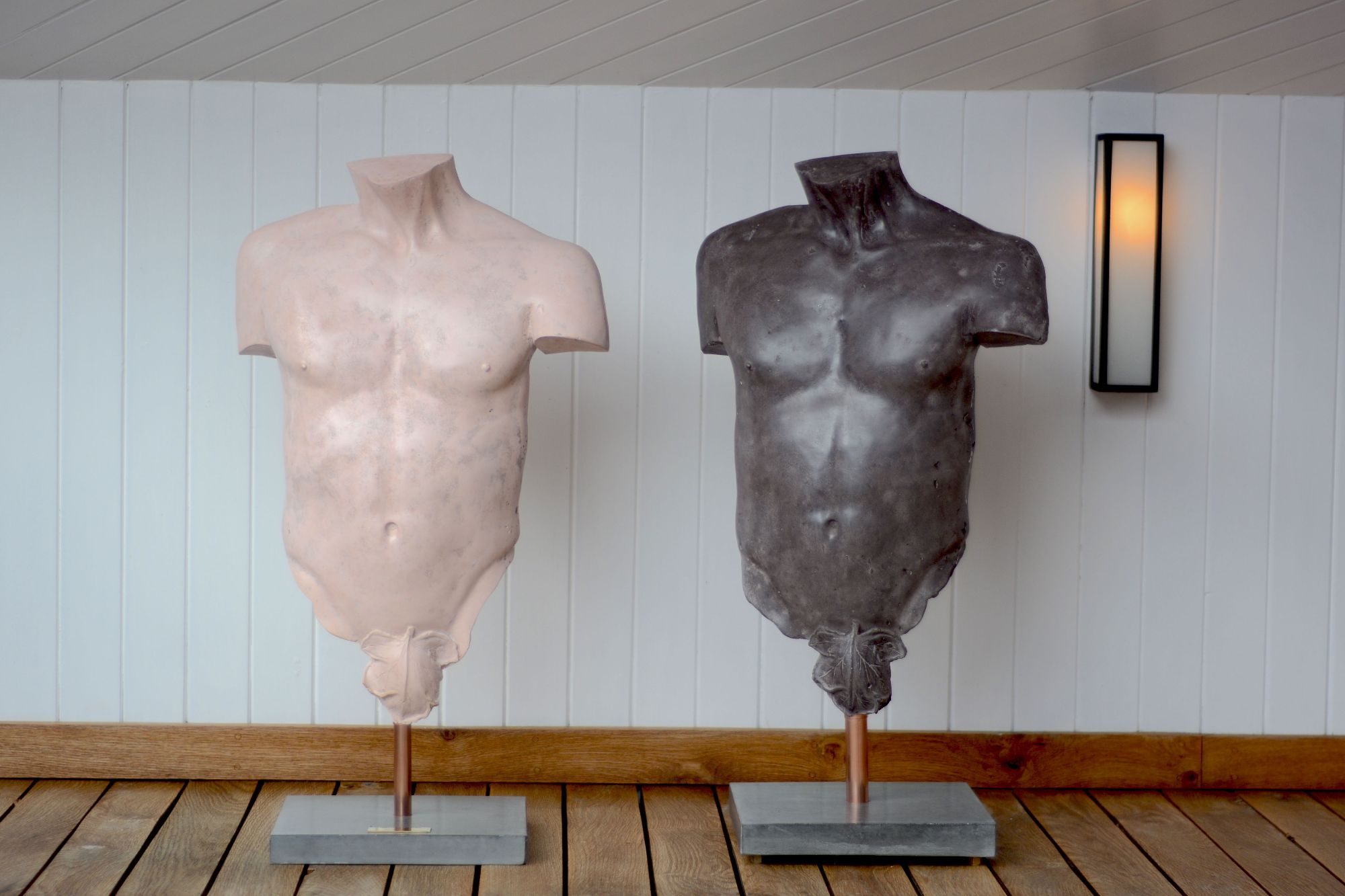 Pink and black polished concrete male torso sculptures
