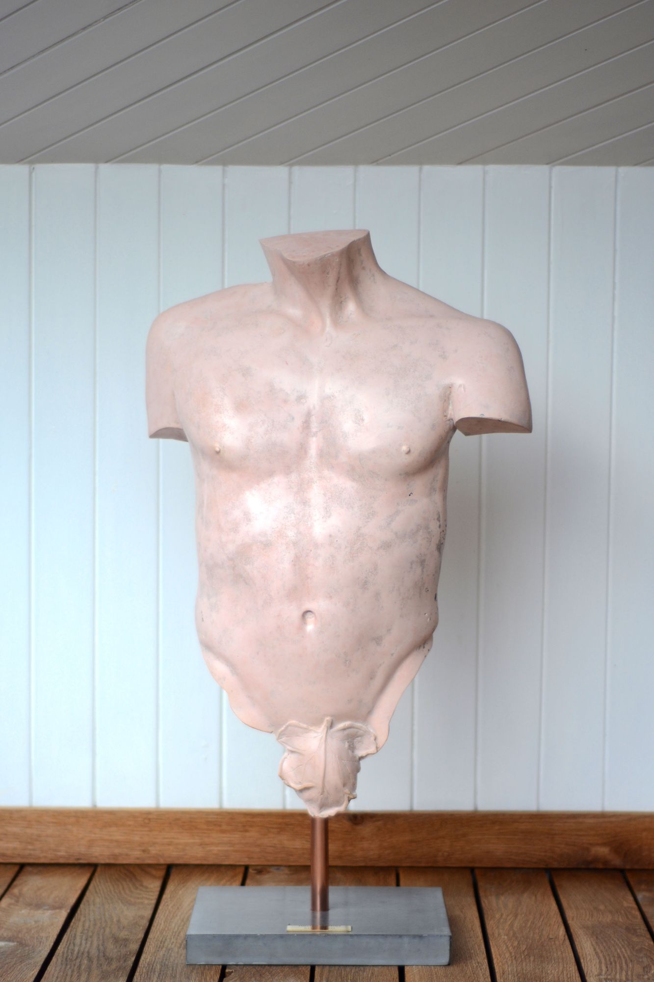 Pink polished concrete male torso sculpture