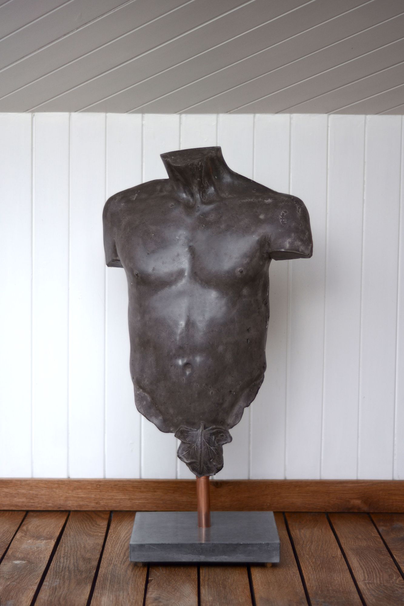 Black polished concrete male torso sculpture