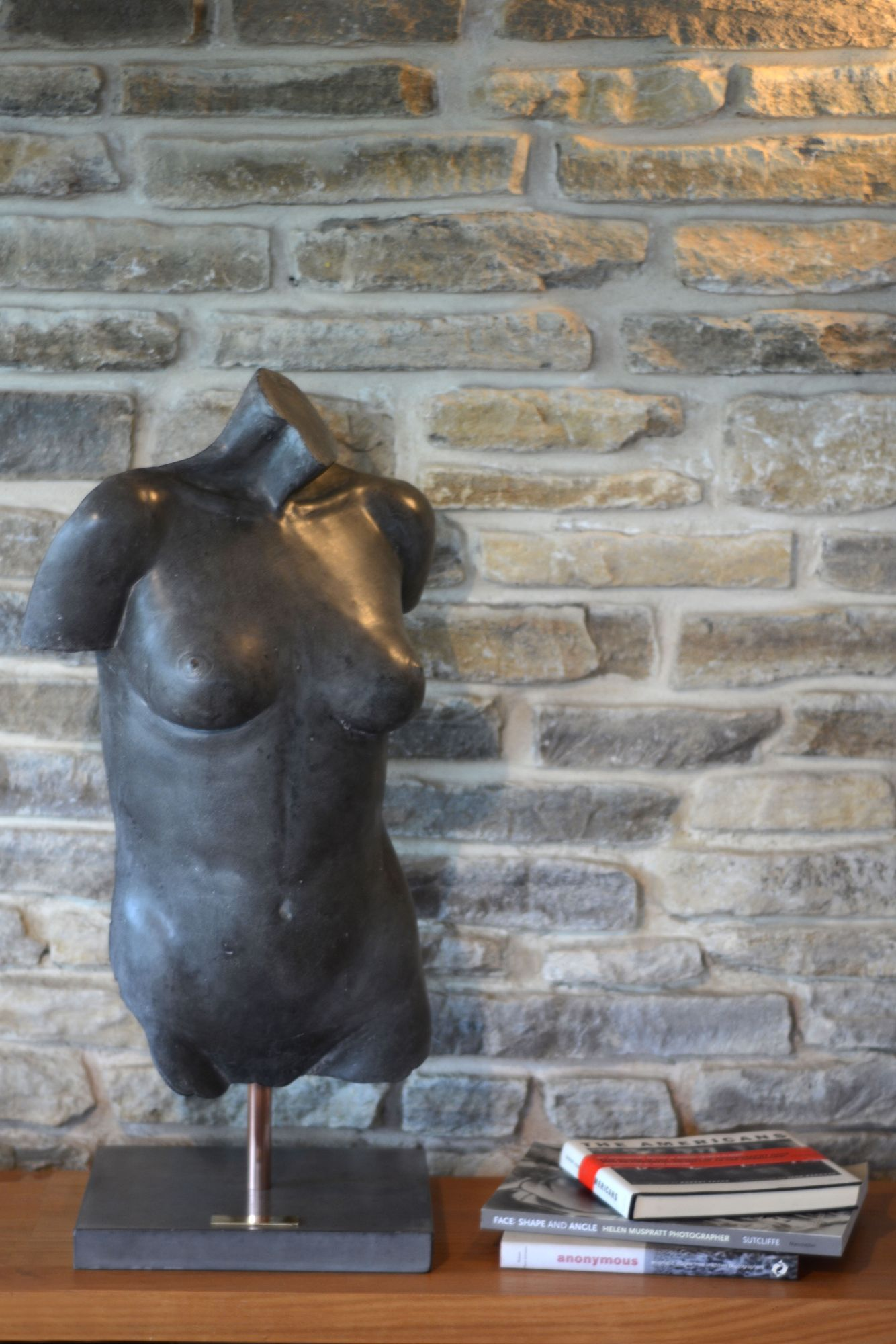 Black polished concrete female figure