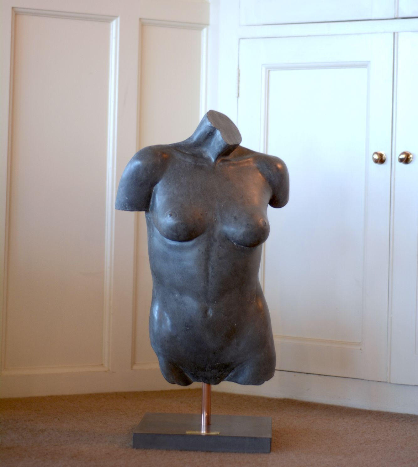 Black polished concrete female torso sculpture