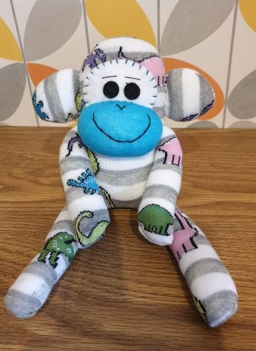 Sock Monkey With Dinosaurs