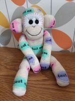Sock Monkey with tweet me, call me, text me slogans
