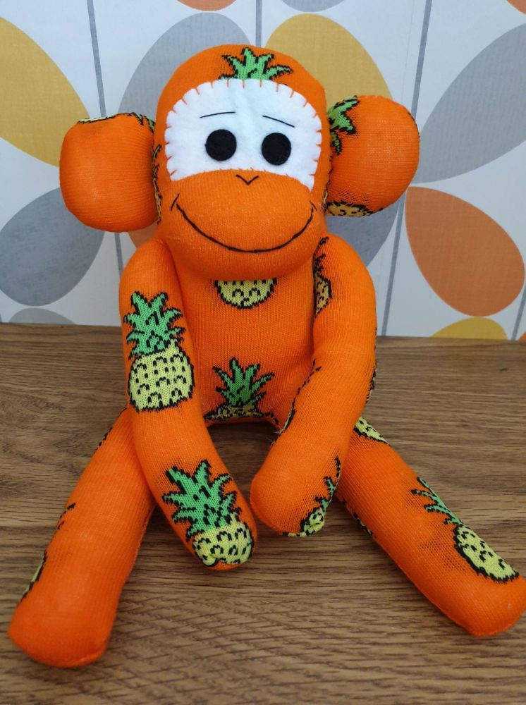 Orange Sock Monkey with Pineapples