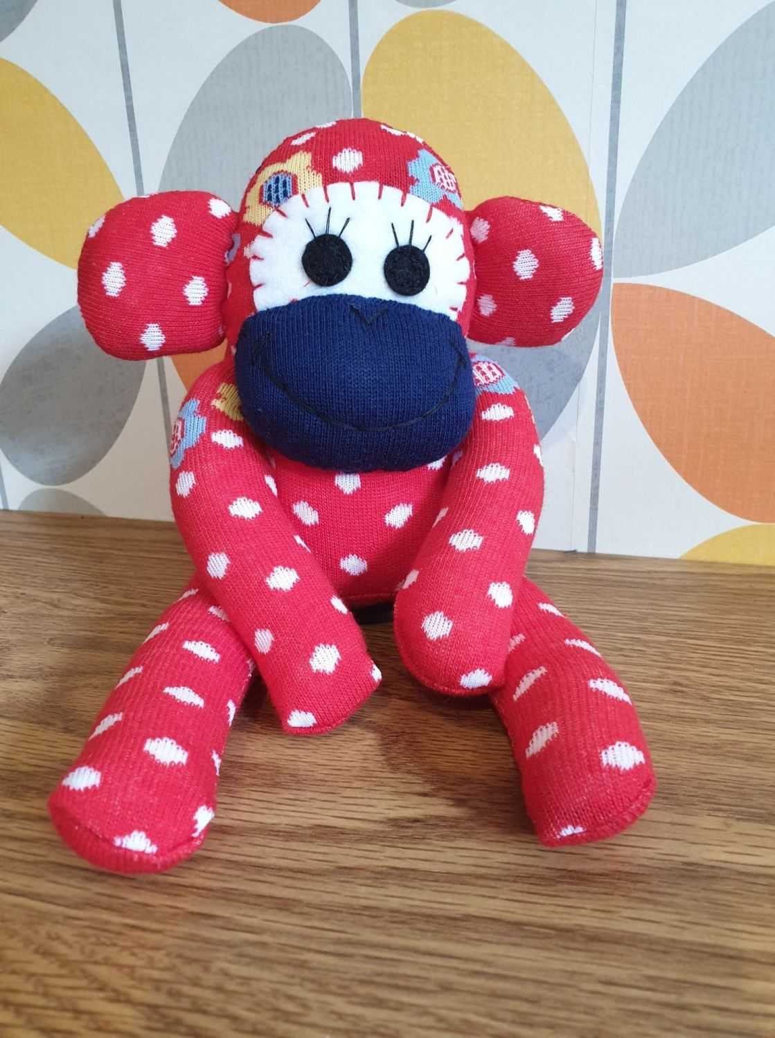 Red Sock Monkey with Spots and flowers