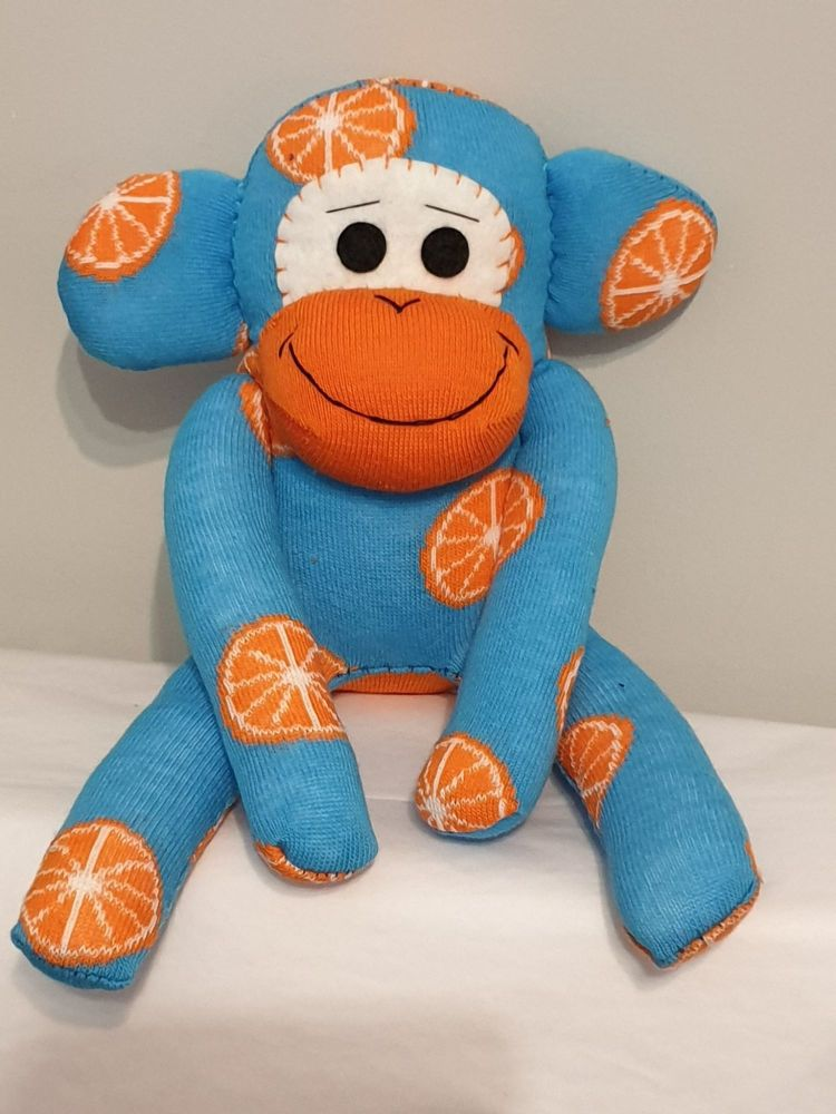 Bright Blue Sock Monkey with Oranges design