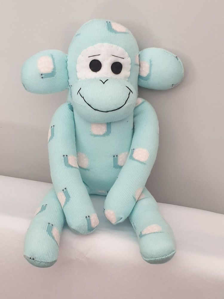 Light Aqua Blue Sock Monkey with snail design