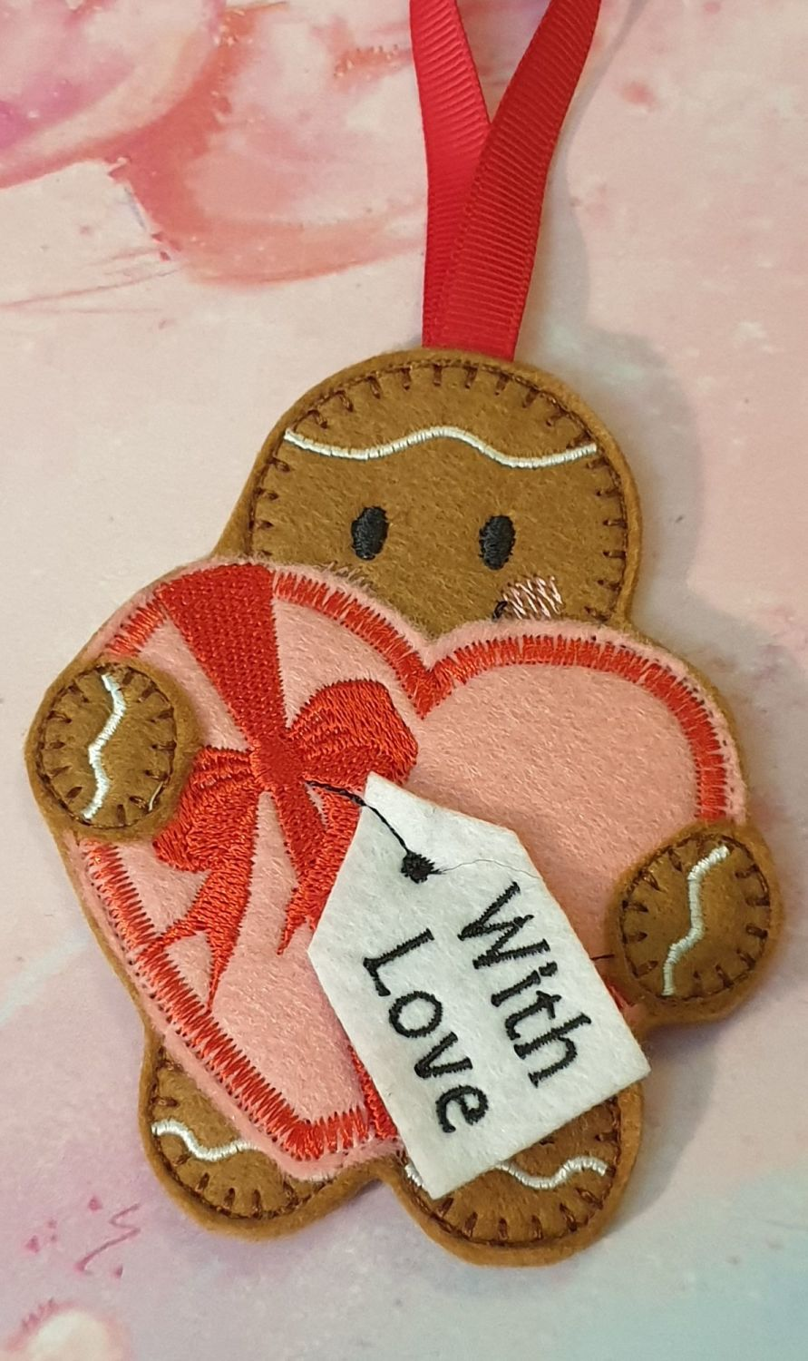 Gingerbread Holding Large Heart shaped box of Chocolates