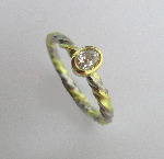 Two Colour Gold And Palladium 'Twist' Diamond Solitaire Ring