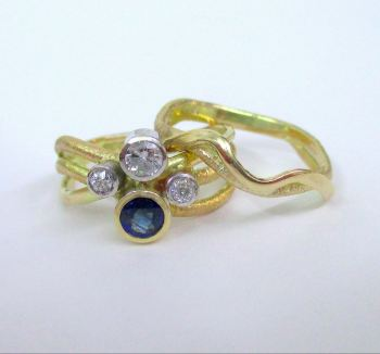 Sapphire Squiggle Engagement Ring With Matching Wedding Ring