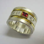 Red Sapphire and Scattered Diamonds In A Gold Spinning Ring