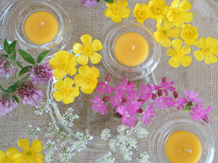 floating beeswax candles and flowers