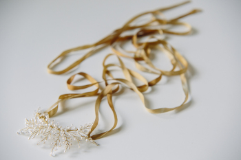 gold crystal and pearl crescent with ribbons