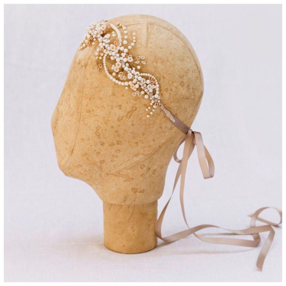 Winter rose gold headdress on mannequin