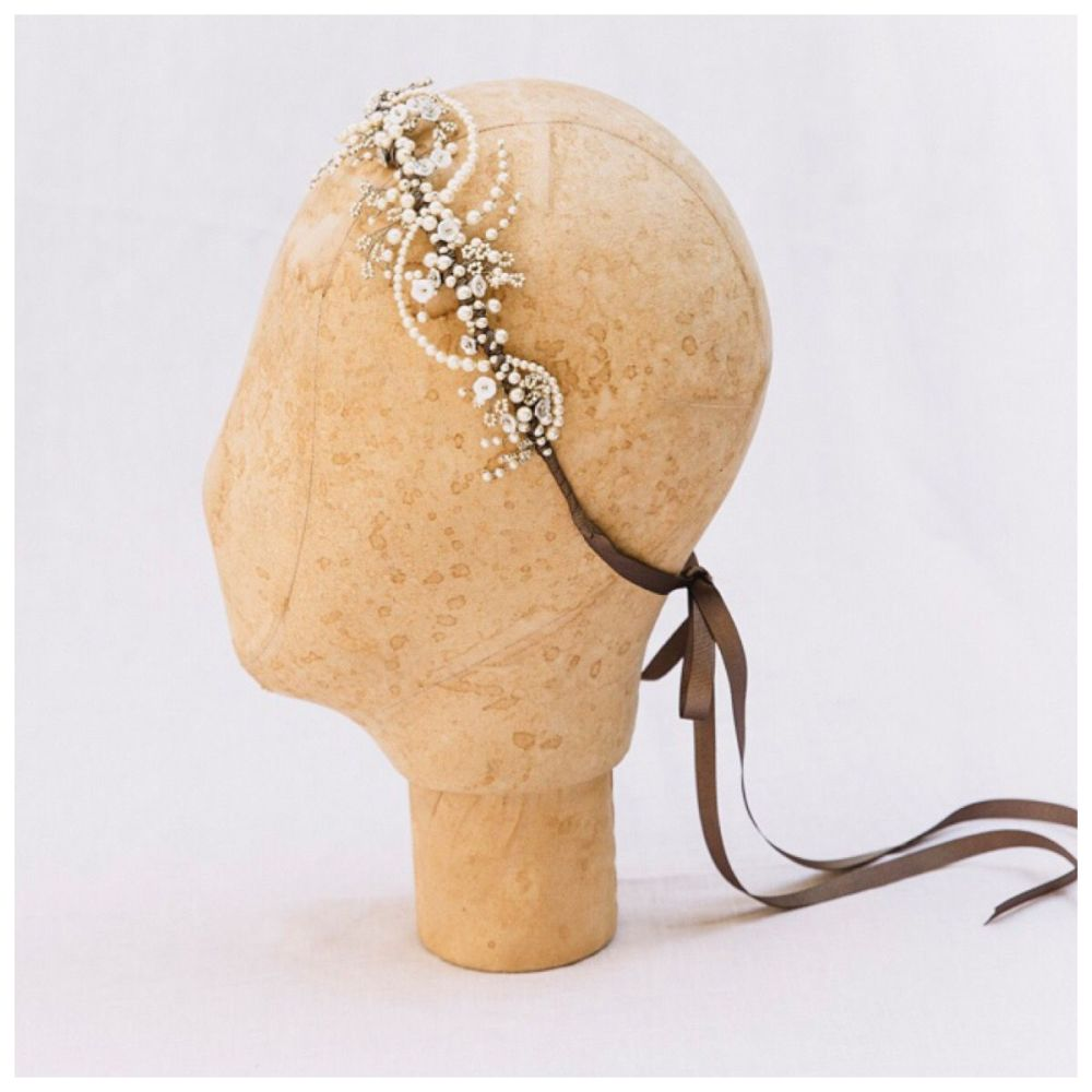 Winter rose silver headdress on mannequin