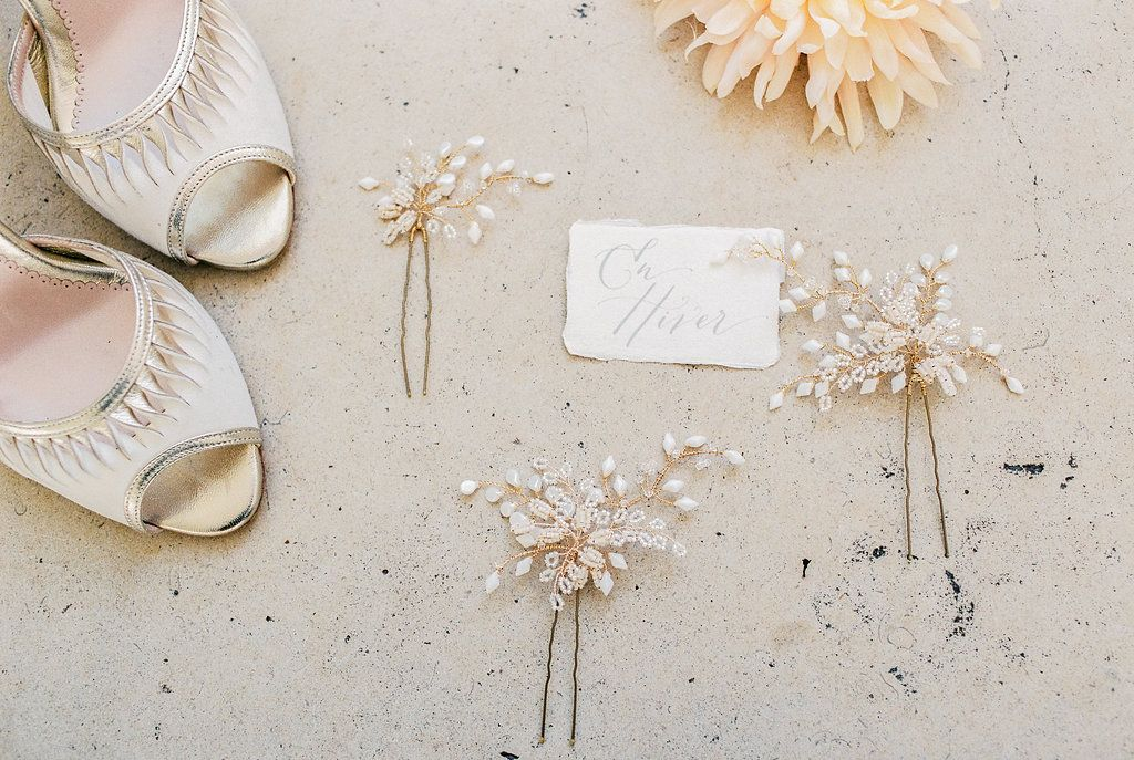 Delicate beaded bridal hair pins handmade by Clare Lloyd and a pair of Emmy London Shoes