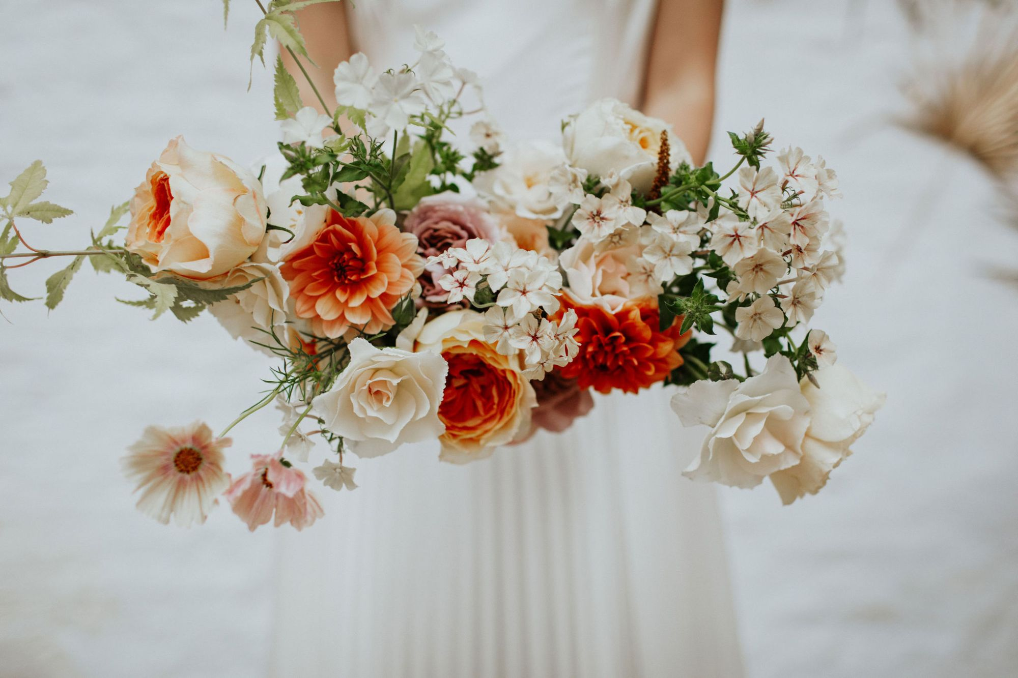 coral and ivory bridal bouquet by Clementine Moon Florist in Bristol