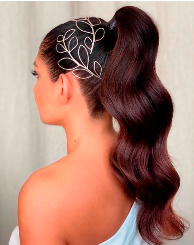 Bridal hair style created by Kasia Fortuna with a high ponytail and two silver leaf headpieces