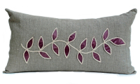 Linen cushion with steel leaf design